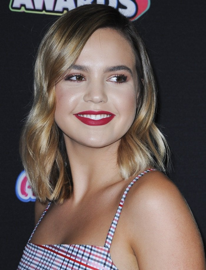 Bailee Madison with die parted light wavy tresses at the 2018 Radio Disney Music Awards held in Los Angeles on June 22, 2018