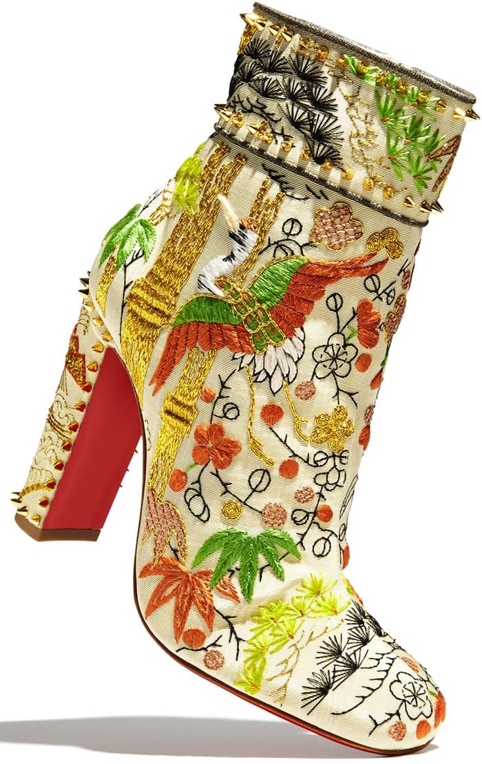 These exquisite Asian-inspired statement boots are designed with embroidered cranes, foliage and florals and feature a covered heel with spike studs, square toe, side zipper closure and the designer's signature red lacquer sole