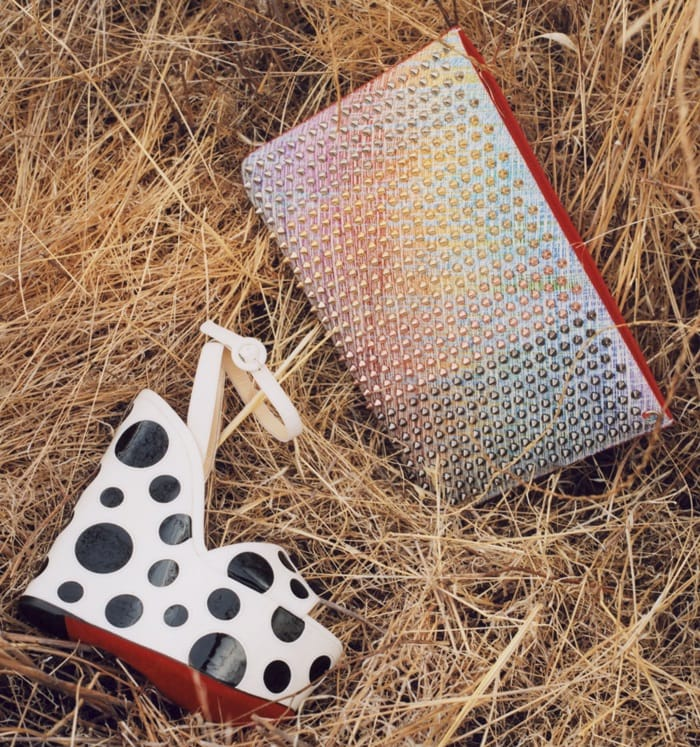 A sky-high platform wedge lends a little extra oomph to a dramatic ankle-strap sandal updated in playfully oversized bubble dots