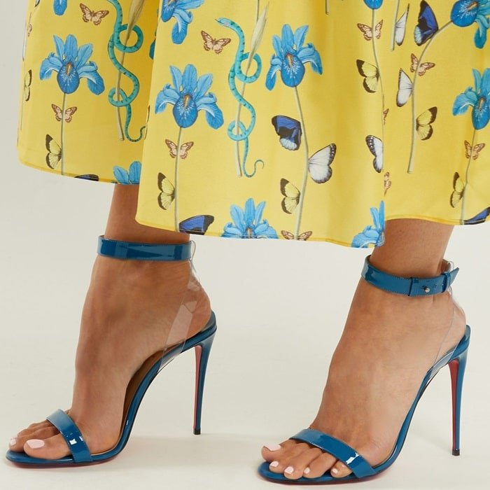 These blue leather sandals are crafted with clear PVC panels to create the striking impression of floating ankle straps