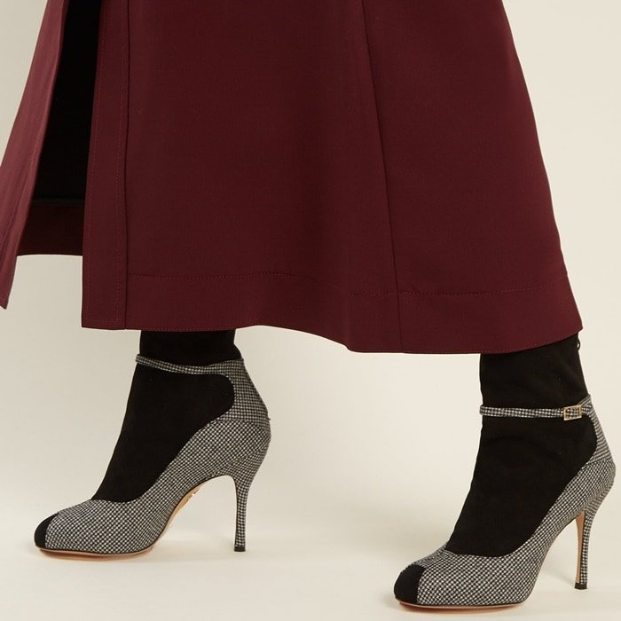 Charlotte Olympia's Incognito boots are aptly named for the black suede sock-like panels that splice the black and white hound's-tooth wool sides, stiletto heel, and buckle-fastening strap