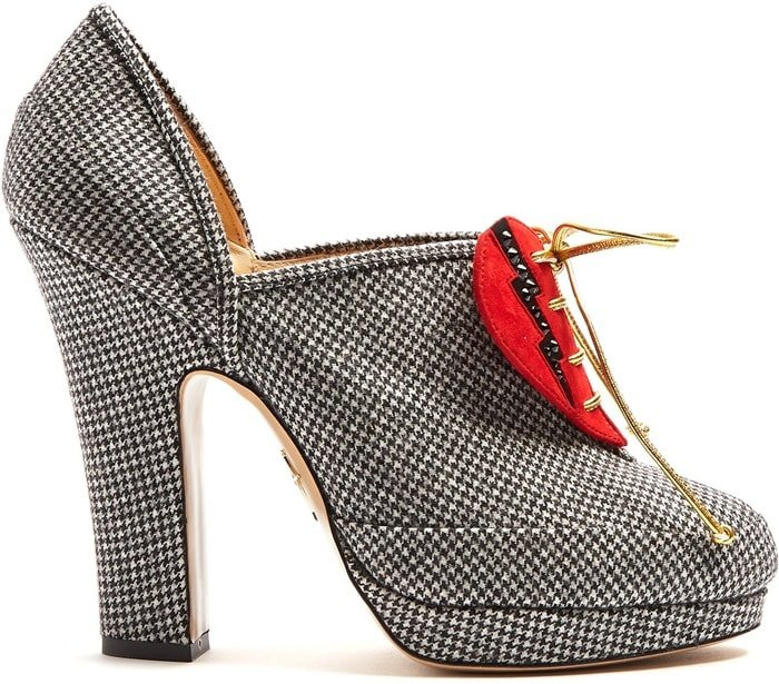 Stand out in Charlotte Olympia's black and white hound's-tooth Leading Lady pumps.
