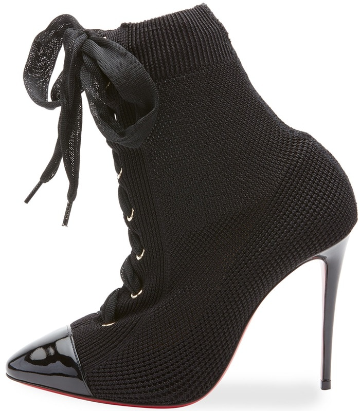 b66610578d0a Christian Louboutin s black knit Frenchie lace-up ankle boots are styled  with a patent leather