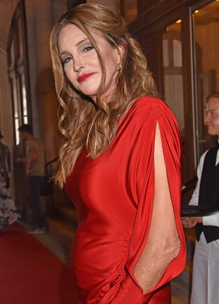 Caitlyn Jenner showed off her figure in a red scarlet floor-length gown featuring cold-shoulder detail