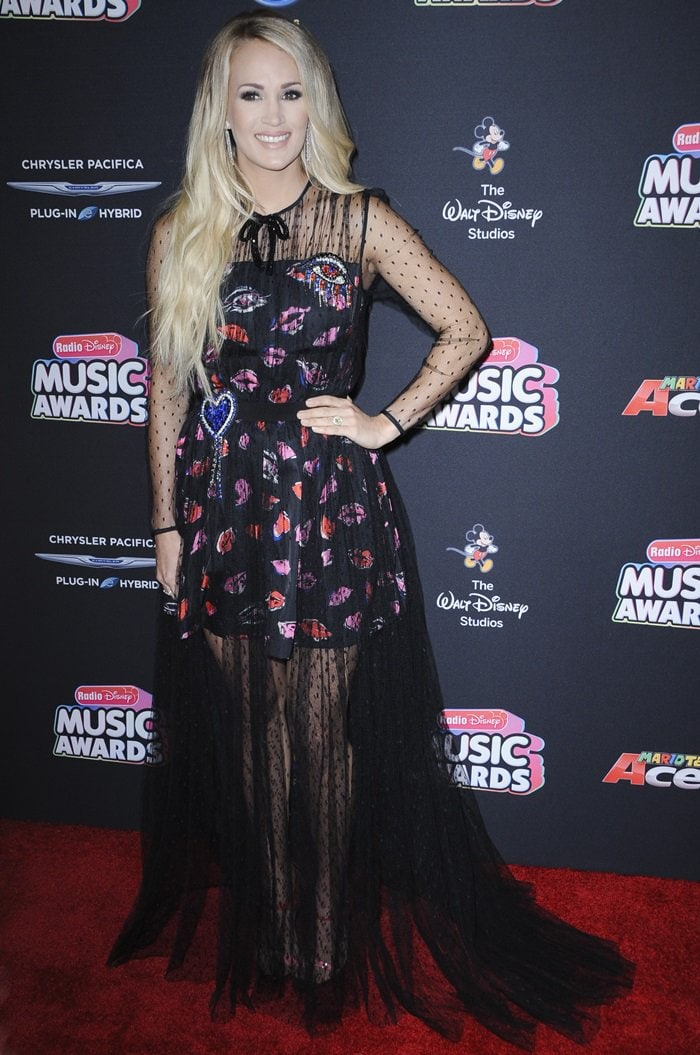 Carrie Underwood turned heads in a MSGM lip printed tulle dress with jewel embroidery