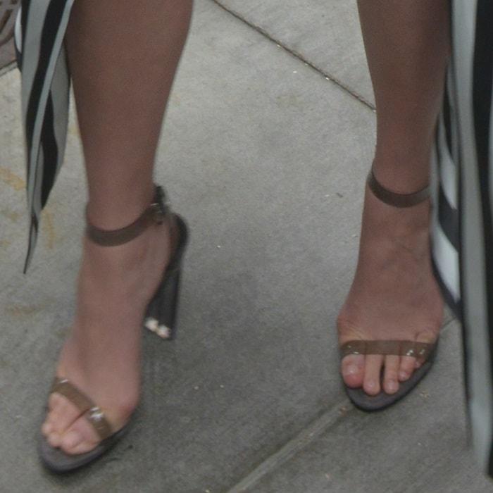 Chrissy Teigen's feet inYeezy Season 6 PVC ankle-strap sandals