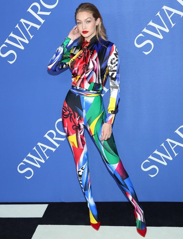 Gigi Hadid ina multicolored graphic brushstroke print Versace Fall 2018 jumpsuit