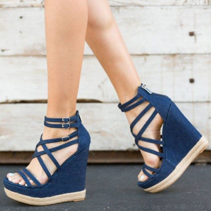 Sexy strappy caged high platform wedge sandal with braided jute detail, functional buckles, and back zip closure
