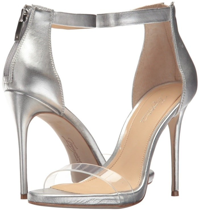 A transparent toe strap furthers the elegant minimalism of a soaring ankle-strap sandal from Vince Camuto