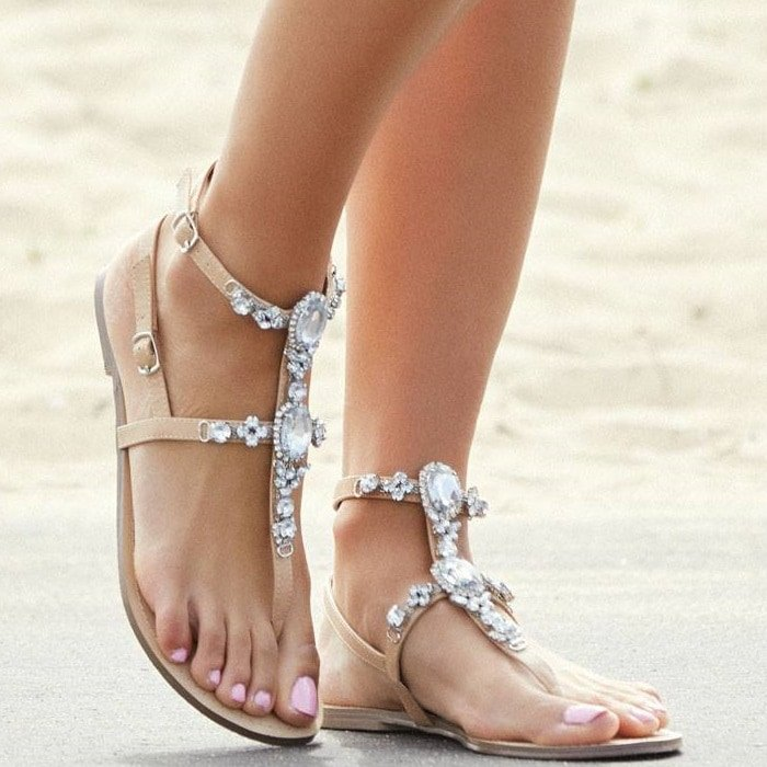 Sexy t-strap flat sandal with rhinestone embellishments and double buckle detail