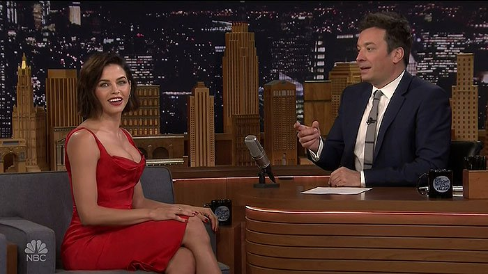 "Jenna Dewan wearing a Zac Posen red satin dress with Jennifer Meyer jewelry during her guest appearance on ""The Tonight Show Starring Jimmy Fallon"""