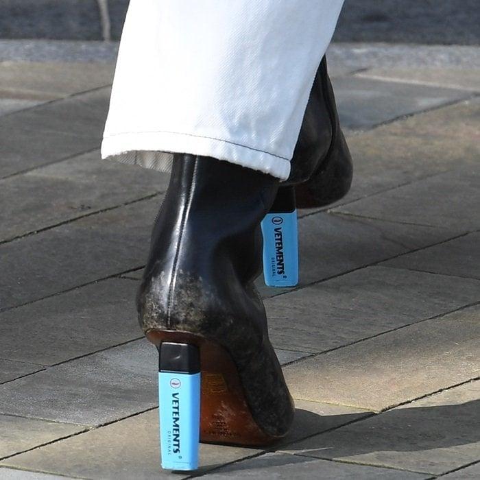Jess Glynne rocking highlighter-heel leather ankle boots