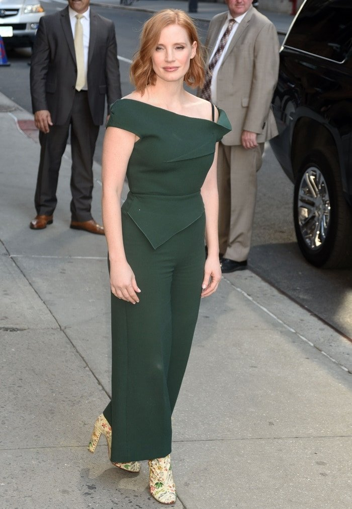 Jessica Chastain in a green 'Gable' peplum wool-crepe jumpsuit from Roland Mouret