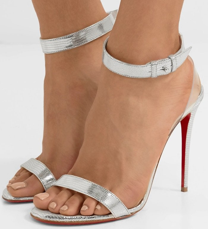 These hot sandals are made from silver lizard-effect leather and trimmed with clear PVC to create the illusion of floating ankle straps