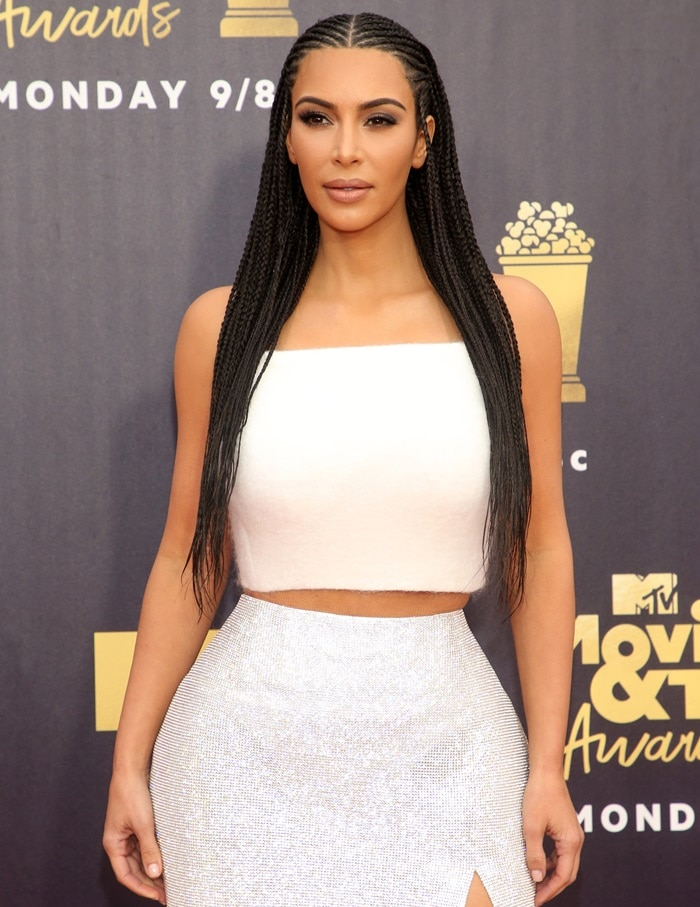 Kim Kardashian in a white mohair halter top paired with a crystal mesh column skirt from Atelier Versace