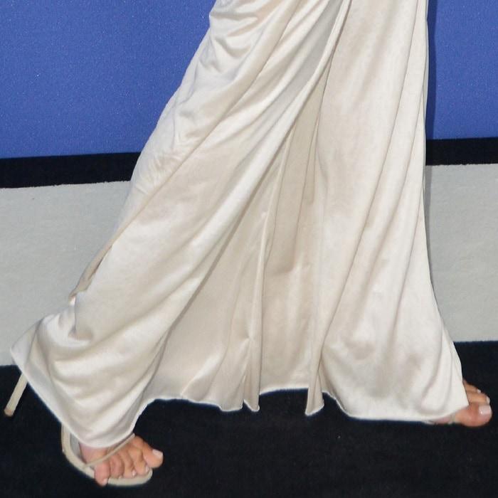 Kim Kardashian's feet scratching the carpet in Yeezy sandals