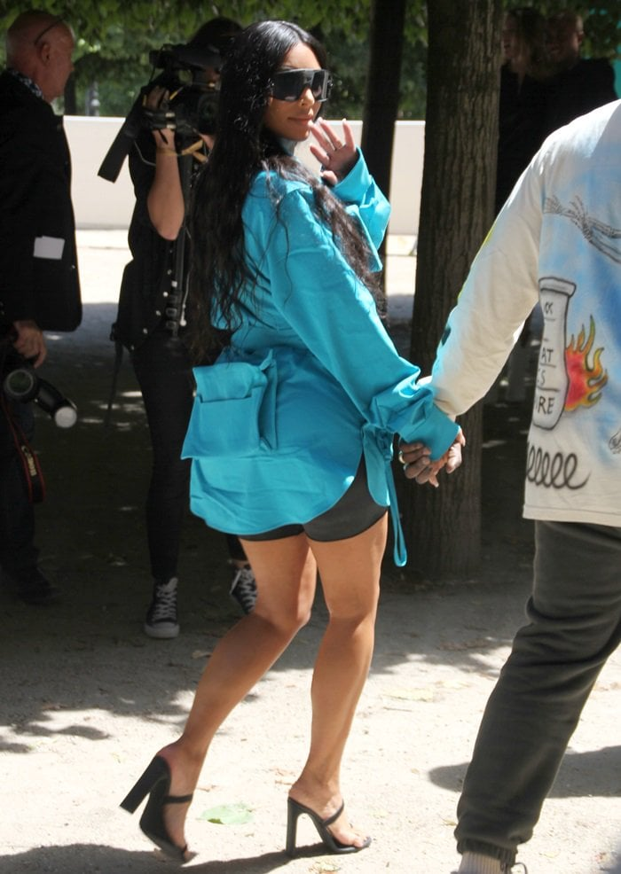 Kim Kardashian rocked a blue shirt from Virgil Abloh's Louis Vuitton debut collection and Yeezy sandals