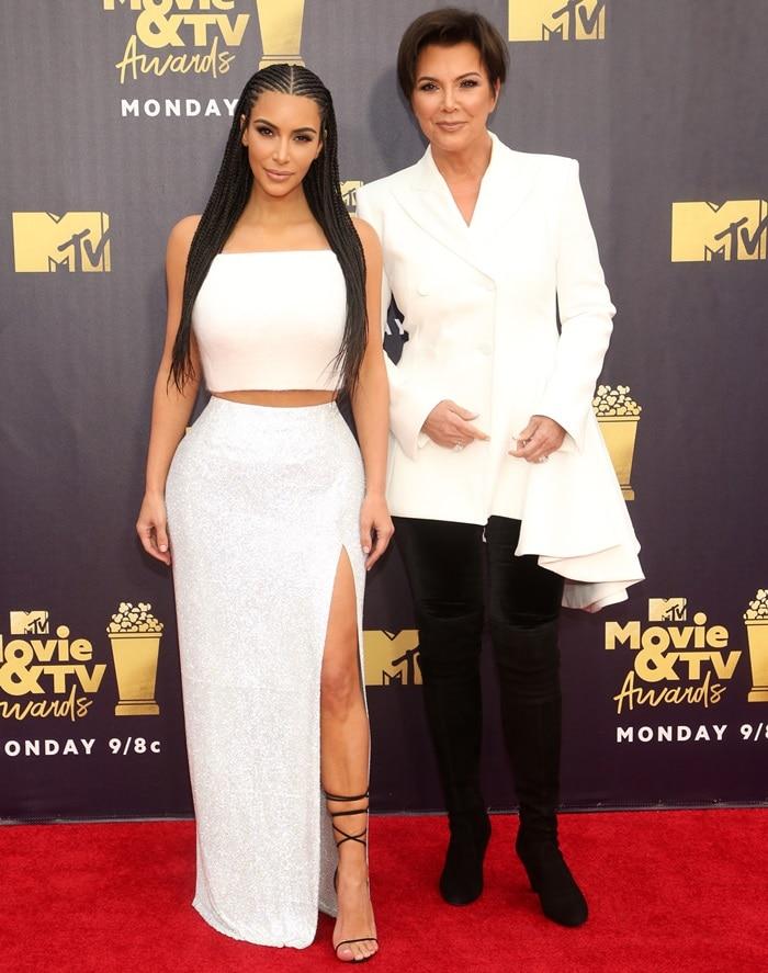 Kim Kardashian posing with Kris Jenner at the 2018 MTV Movie & TV Awards at Barker Hangar in Santa Monica, California, on June 16, 2018