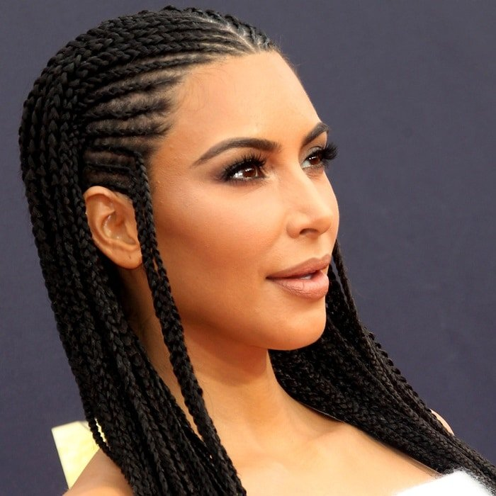 Kim Kardashian with her hair in neat braids at the 2018 MTV Movie & TV Awards at Barker Hangar in Santa Monica, California, on June 16, 2018