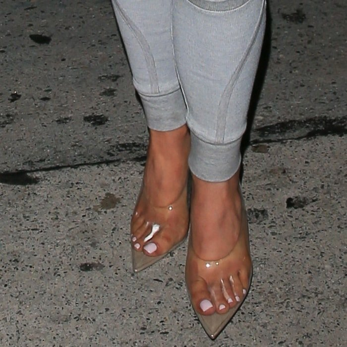 Kylie Jenner showing off her feet in clear Yeezy shoes