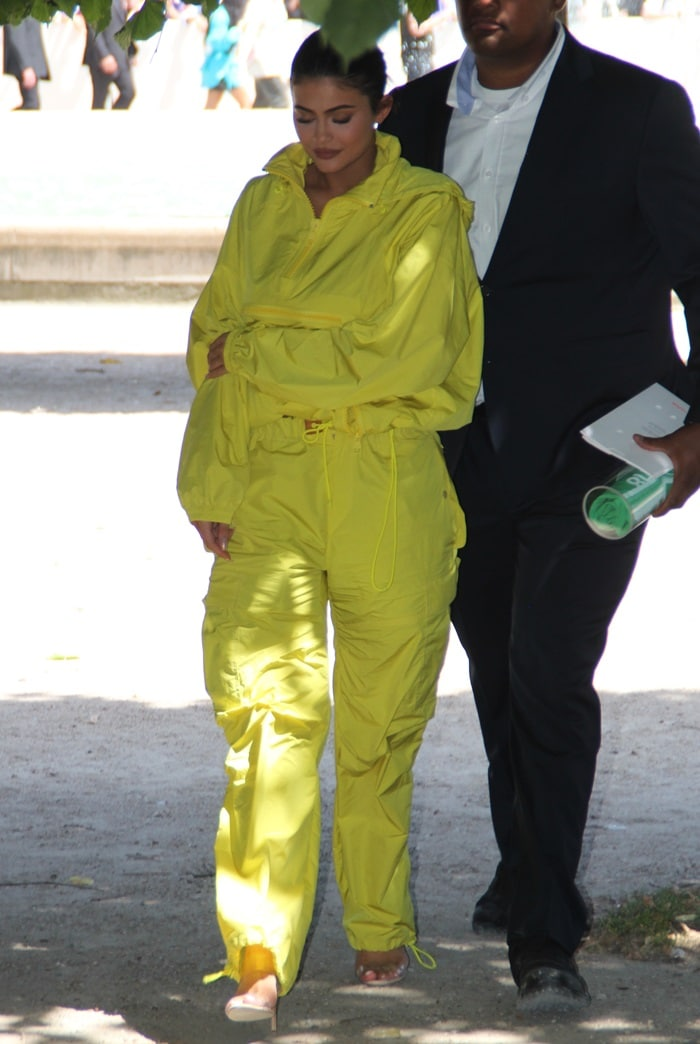 Kylie Jenner styled her yellow cargo pants withclear strap mules from Manolo Blahnik