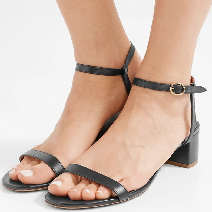 These versatile black sandals have been made in Italy from supple leather and rest on a comfy low block heel