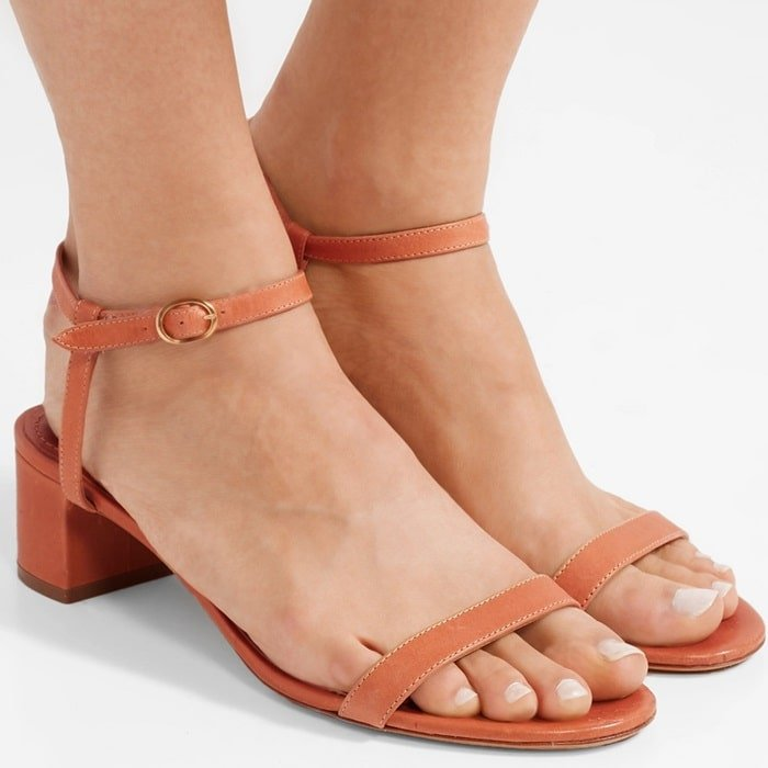 These versatile camel sandals have been made in Italy from supple leather and rest on a comfy low block heel