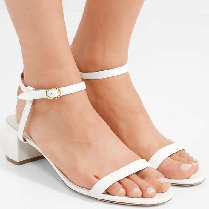 These versatile white sandals have been made in Italy from supple leather and rest on a comfy low block heel