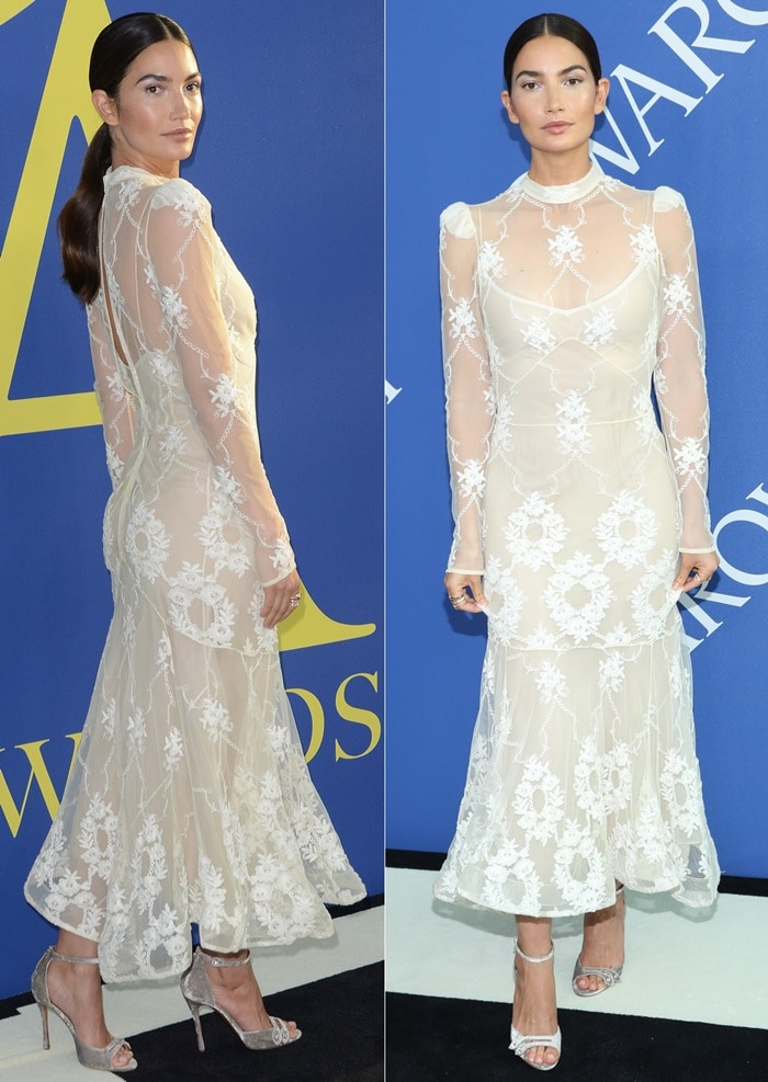Lily Aldridge wearingaBrock Collection 'Diara' dress featuring puffed shoulders and a keyhole back