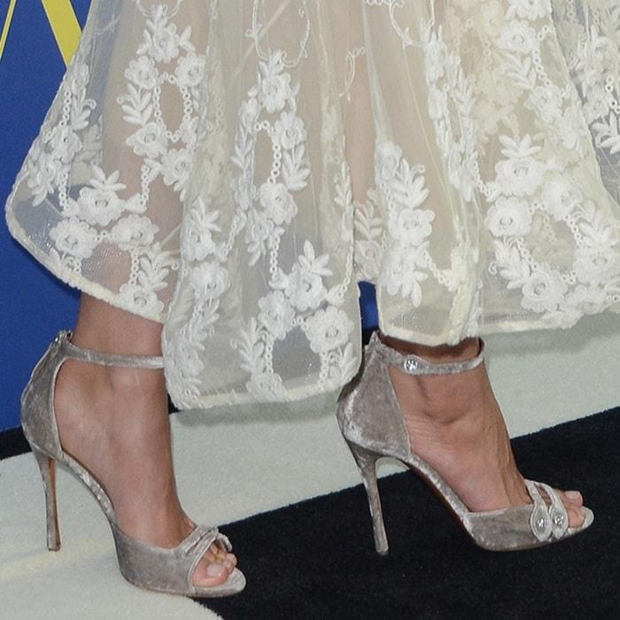 Lily Aldridge's feet inlight pink velvet 'Mali' sandals with Swarovski crystal buttons
