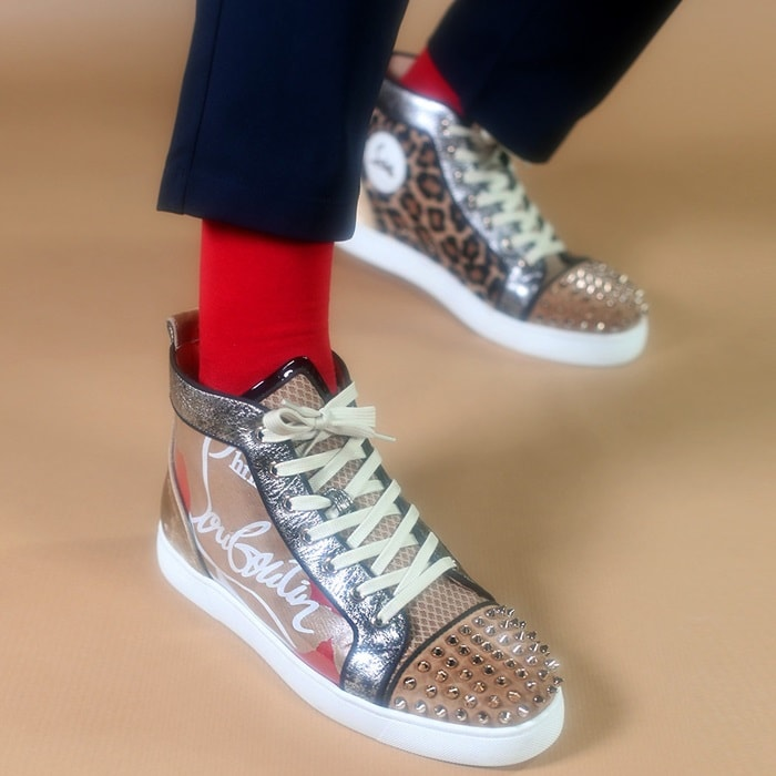 The sleek Lou Spikes high-top sneakers showcase Christian Louboutin's craftsmanship in a variety of textures and materials