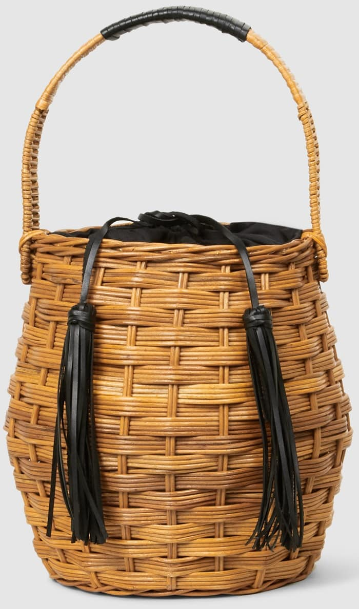 The Marais woven wicker bucket bag's curved silhouette is offset with tassels that double as a drawstring closure