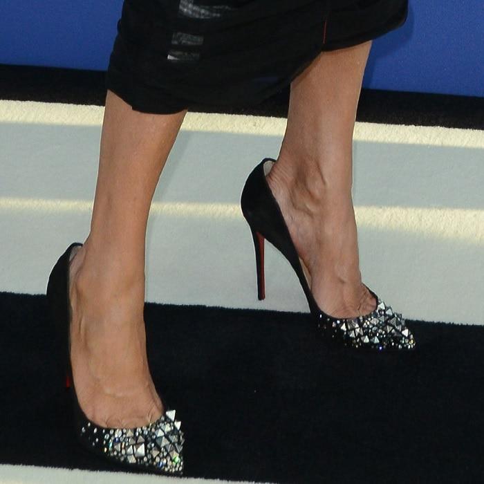 Nadja Swarovski's feet in pyramid stud 'Keopump' pumps
