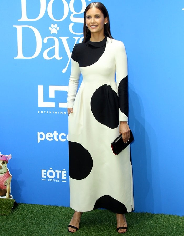 Nina Dobrev's dress has an exaggerated polka-dot print and is cut to an elegant ruffled high neck