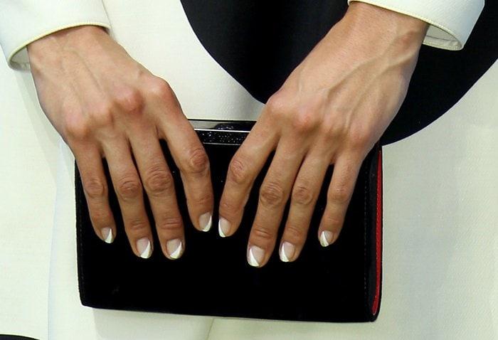Nina Dobrev shows off her black dress and manicure