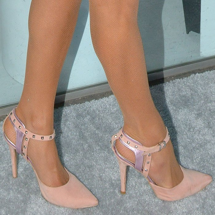 Paris Hilton in pink-suede studded ankle-strap pumps.