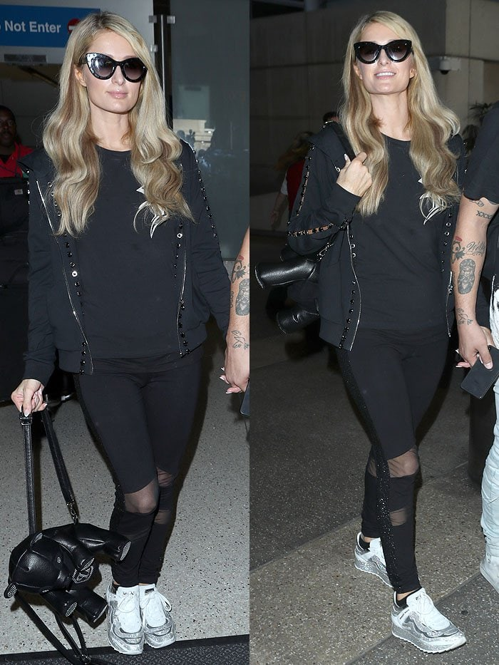 Paris Hilton wearing an all-black ensemble with a Philipp Plein bear backpack and Philipp Plein crystal sneakers.