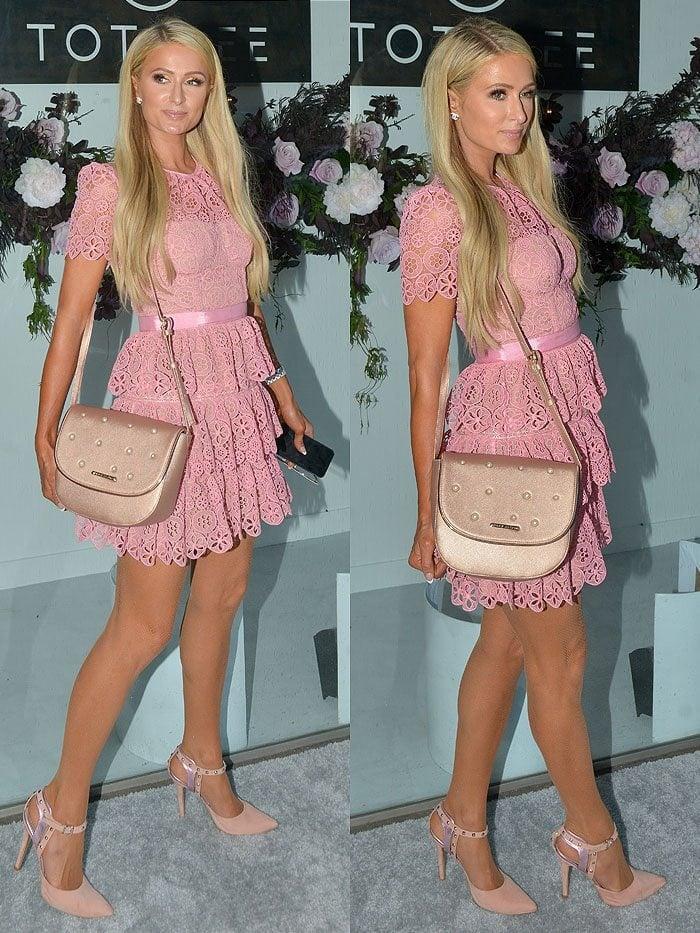 Paris Hilton wearing her own Paris Hilton studded ankle-strap pumps and handbag.