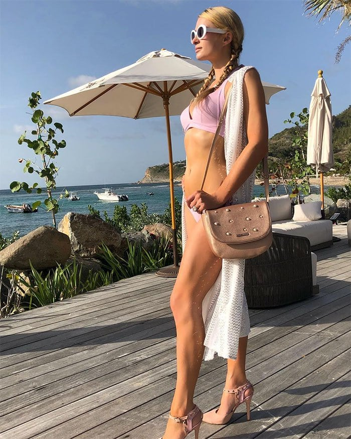 Paris Hilton on vacation in St. Barts in a pink bikini, pink heels, and a pink handbag.