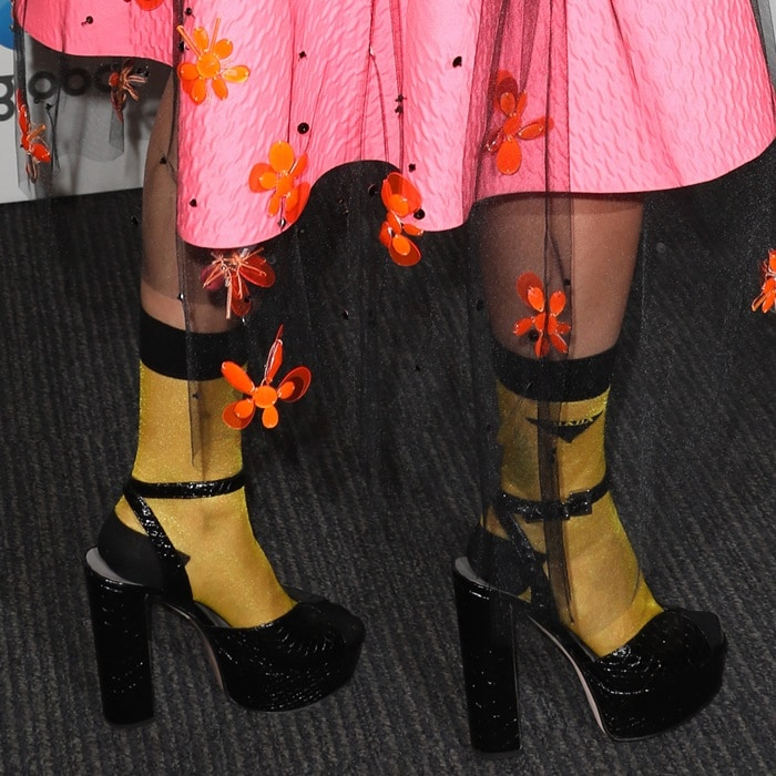 Rita Ora rocking chunky black shoes and mustard-colored socks