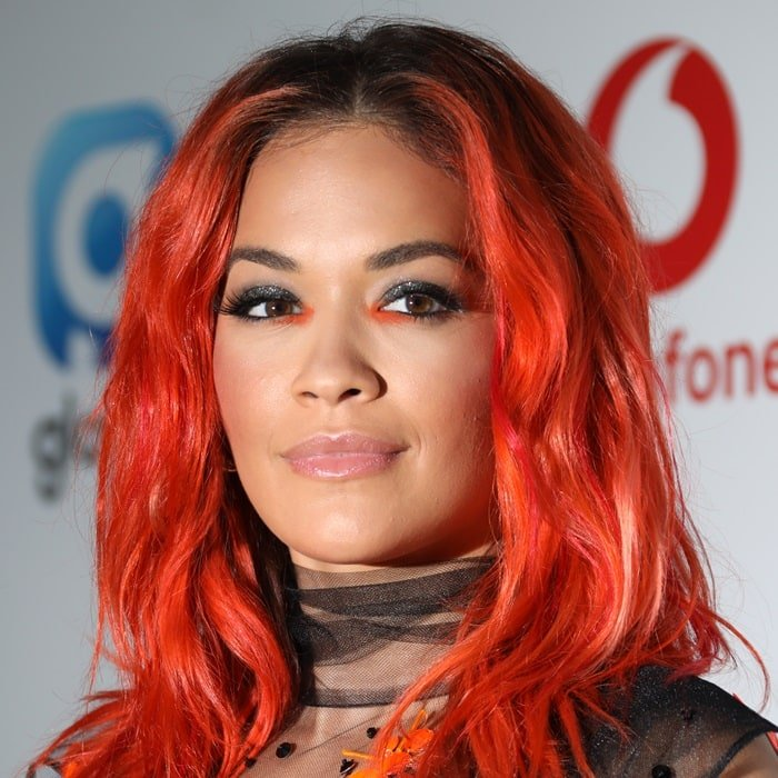 Rita Ora's dyed red locks at the 2018 Capital FM SummerTime Ball at Wembley Stadium in London, England, on June 9, 2018