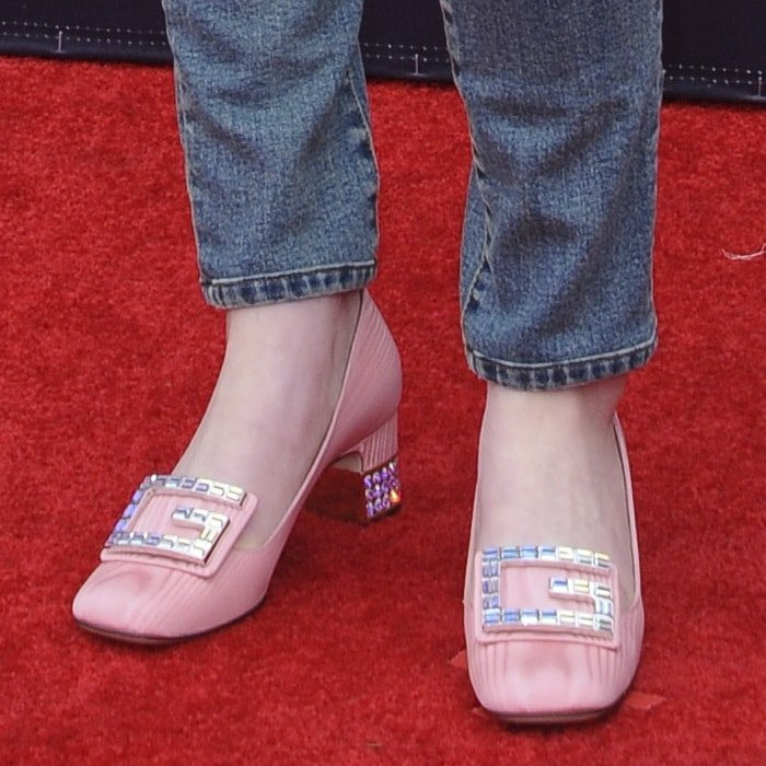 Sadie Sink's feet in light pink 'Madelyn' silk moiré pumps