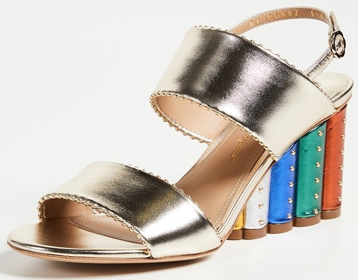 This studded metallic sandal is brightened with a spectrum of bold colors