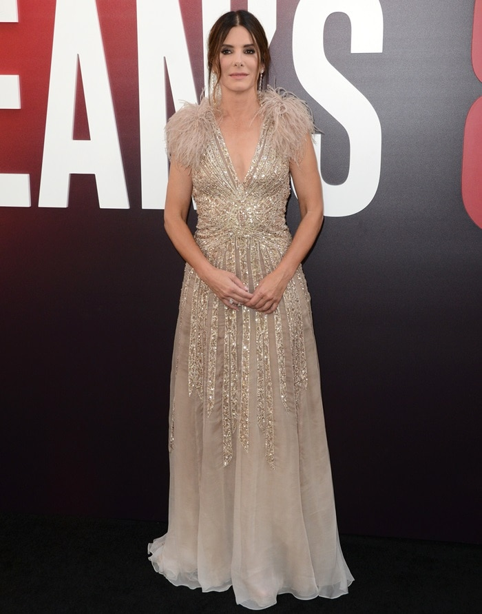 Sandra Bullock disappointed in a feather-embellished dress from Elie Saab