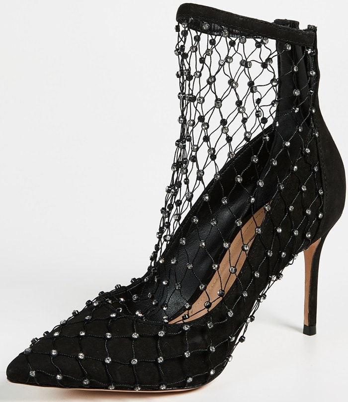 Delicate fishnet sock with crystals covers chic pumps