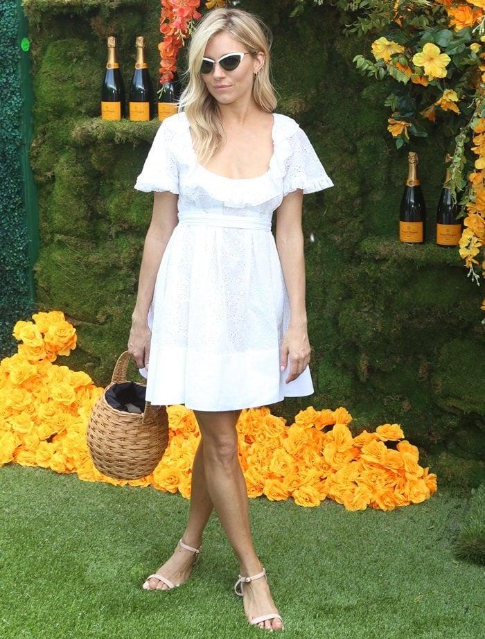 Sienna Miller toting a 'Marais' woven wicker bucket bag fromAranaz
