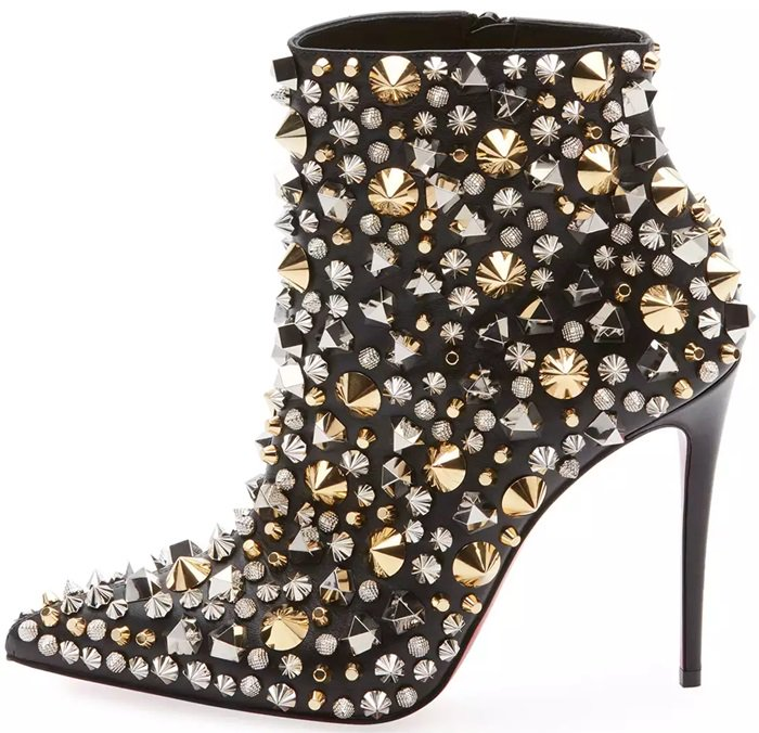 These black nappa leather ankle boots are adorned with polished silvertone and goldtone hardware