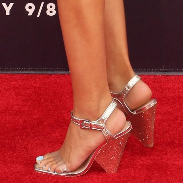 Storm Reid's feet in cone heel sandals from Schutz