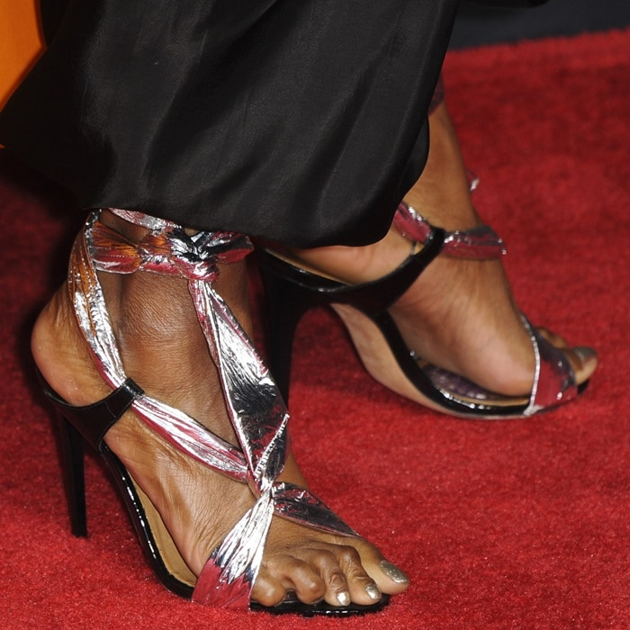 Sydelle Noel showing off her feet in silver wrap ankle tie shoes