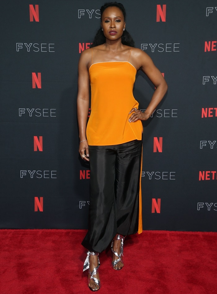 Sydelle Noel wearing blackRachael Cassar harem pants at the GLOW Emmy for Your Consideration event held at the Netflix FYSee at Raleigh Studios in Los Angeles on May 30, 2018